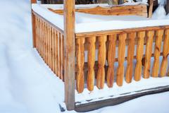 detail of outdoor porch in winter - stock photo