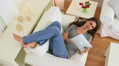 Happy woman using ipad to share a photo Stock Footage