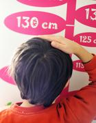 Cute kid measuring his height Stock Photos