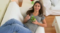 Happy woman smiling and eating healthy salad Stock Footage