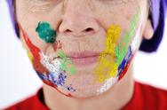 Elderly woman grandmother with painted face over white background Stock Photos