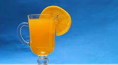 Green straw in a yellow juice in a blue background - stock footage