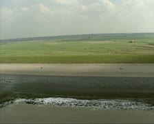 Aerial shot Dutch sea defence Hondsbossche Zeewering  + cyclists Stock Footage