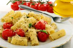 pasta with tomatoes closeup. - stock photo
