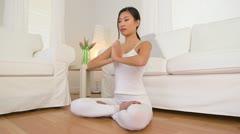 Asian woman doing meditation - stock footage