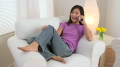 Chinese woman talking on the phone - stock footage