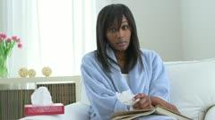 Sick African American woman drinking tea Stock Footage
