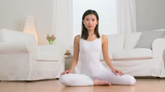Stock Video Footage of Asian woman sitting on floor in yoga attire