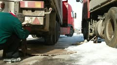 Repairing  truck in winter - stock footage
