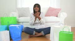 Happy excited black woman cheering with her shopping bags Stock Footage