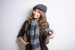 Young woman with retro film camera. Stock Photos