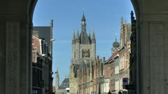 The Cloth Hall viewed from through the Menin Gate, Ieper, Belgium Stock Footage