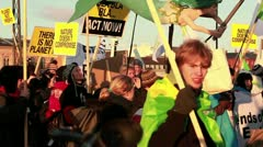 Environmental activists march in a parade on Earth Day. Stock Footage