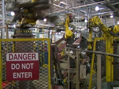 Stock Video Footage of Robotic Arms Weld And Load Metal Vehicle Parts