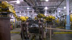 Stock Video Footage of Time-lapse Automotive Robotic Arms Automation Welding Assembly Line Automotive