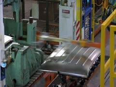 Vehicle Roof Being Stamped At A Factory Stock Footage