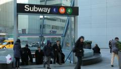 Commuters walking out of subway station Stock Footage