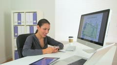 Happy Hispanic business woman excited at desk - stock footage