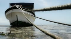 Close up of mooring lines for boat with boat - stock footage