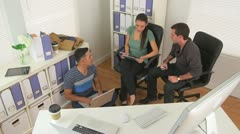 Mexican and Caucasian workers talking in office - stock footage