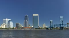 Downtown Jacksonville skyline seen across St. John's river Stock Footage