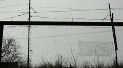 Barbed wire and fence mesh Stock Footage