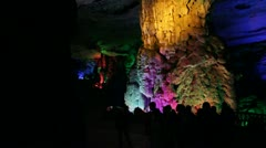 Pan Guilin China famous Seven-Star Cave huge vast cavern tourists walking Stock Footage
