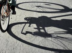 shadow of cyclist - stock photo