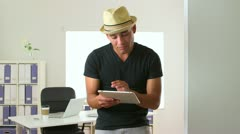 Hispanic business man dancing in office with tablet pc - stock footage