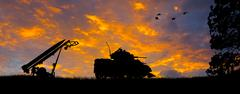Anti-Aircraft Missile and Tank Silhouette Stock Photos