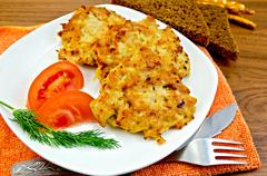 fritters chicken with vegetables and bread on a board - stock photo
