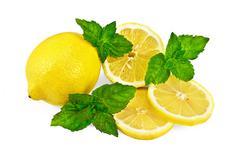 Yellow lemons with mint Stock Photos