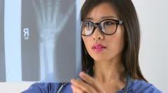 Asian doctor examining x-ray - stock footage