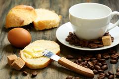 coffee beans, eggs, bread and butter. - stock photo