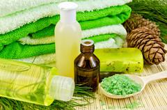 Oil and toiletries with cedar cones Stock Photos