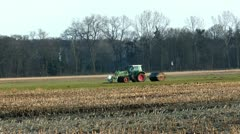 Farm tractor with roller flattening land Stock Footage