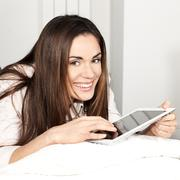 Stock Photo of smiling woman with tablet