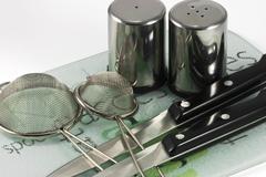 utensils on ceramic tiles - stock photo