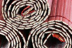Three coiled bamboo mats Stock Photos