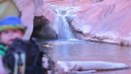Baby in Nature in front of Waterfall Stock Footage