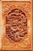 Dragon design on the wooden door Stock Photos