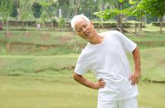 Chinese asian senior male workout in the park Stock Photos