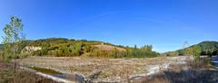 Stock Photo of Reggio Emilia Apennines valley panorama with river and lonely house uphill