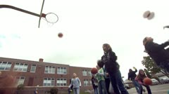 Kids On Playground 8 - Basketball - Two Clips in One Stock Footage