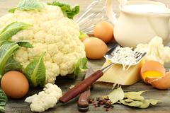 cauliflower for baking with egg and cheese. - stock photo