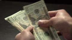 Counting money in slow motion Stock Footage