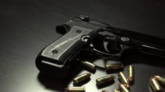 Dolly shot of 9 mm handgun with bullets Stock Footage