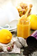Tea with honey and lemon to treat colds. Stock Photos