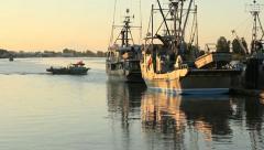Boats Passing Sunrise Seiners, Steveston Stock Footage