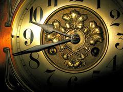 Antique clock close-up - stock photo